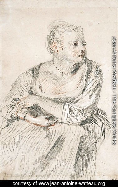 Jean-Antoine Watteau - A seated woman with a generous dcollet, her arms folded on her lap, looking to the right