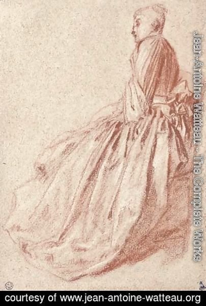 A woman in a long dress, seated in profile to the left